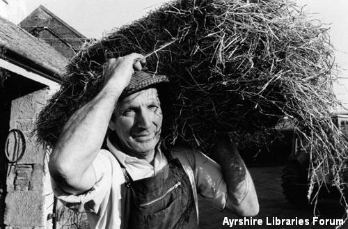Farmer with hay bale